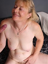 Sexy granny Maria sizing up an erect man meat with her mouth and rubbing her throbbing clit