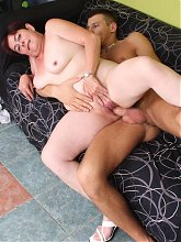 Horny granny Simone admiring a younger cock with her mouth and takes it in her eager muff