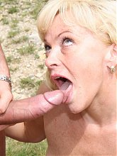 Hot MILF getting nasty under the naked sun