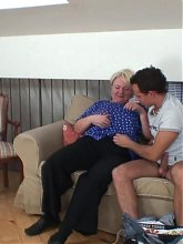 The young man fucks the fat granny with all his might and makes her scream in pleasure