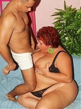 Slutty mature redhead BBW Mindy satisfies a schlong and later enjoys it in her shaved juicy pussy