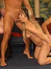 Horny mature and her friends engage in a nasty gangbang session and take turns in getting fucked live